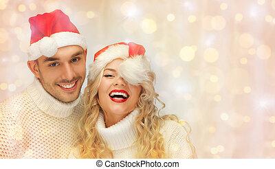 familj, par, jultomten, tröjor, hattar, lycklig
