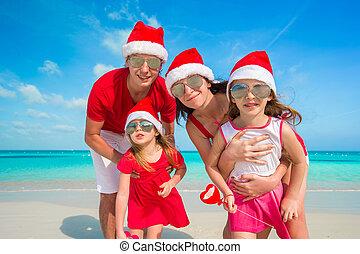 famille, chapeaux, portrait, plage, noël, heureux