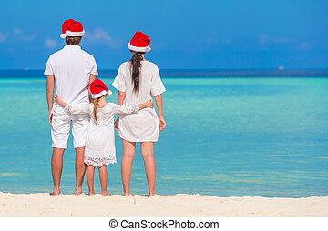 famille, chapeaux, trois, vacances, santa, pendant, plage, noël, heureux