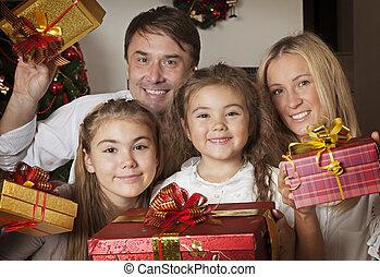 famille heureuse, à, noël dons