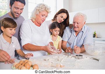 famille heureuse, cuisson, ensemble