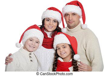 famille, heureux, santa, gosses, poser, chapeaux