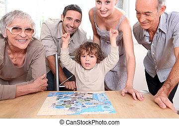 famille, rassemblé, autour de, puzzle