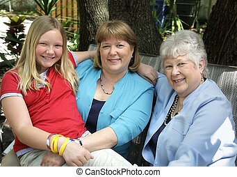 Family - A mother, daughter and grandmother relaxing...