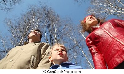 family admires the scenery in park