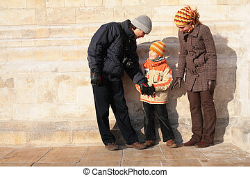 Family against a stone wall