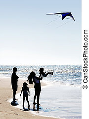Family and a kite - Happy family on the beach