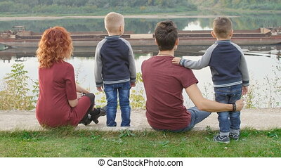 Family and children concept. Young couple with two sons...