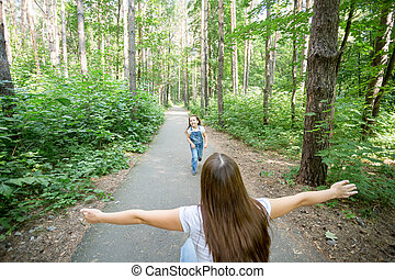 Family and nature concept - Portrait of mother and child playing in the park
