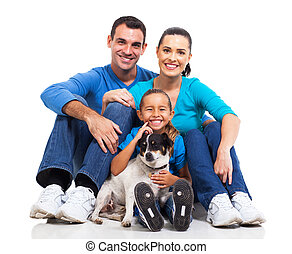 family and pet dog - portrait of cute family sitting on...