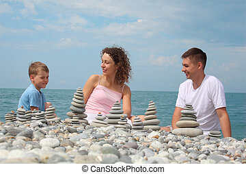 family and  stone stacks on pebble beach