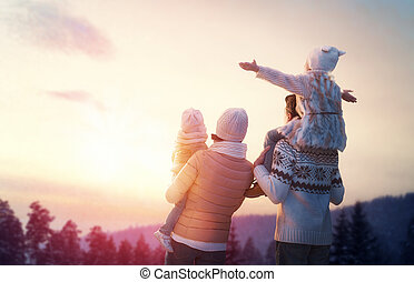 family and winter season - Happy family at sunset. Father, ...