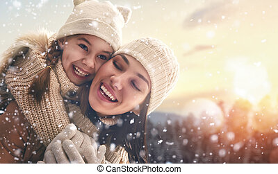 family and winter season - Happy loving family! Mother and...