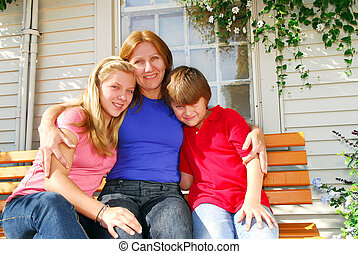 Family at a house - Portrait of a smiling family - mother ...