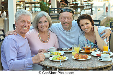 Family at breakfast on resort