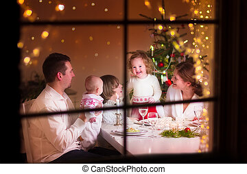 Family at Christmas dinner - Young big family celebrating...