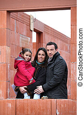 Family at construction site