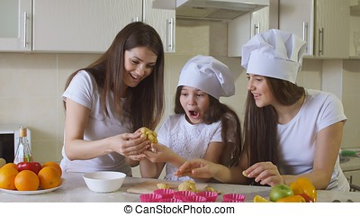 Family at Home in Kitchen Having a Good Time