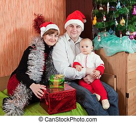 family at  home with  Christmas tree
