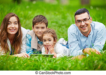 Family at leisure - Adorable kids and their parents spending...