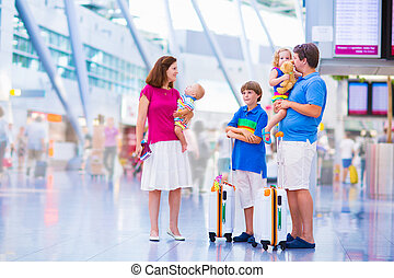 Family at the airport - Big happy family with three kids ...