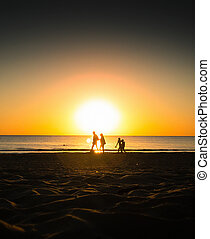 family at the sunset beach