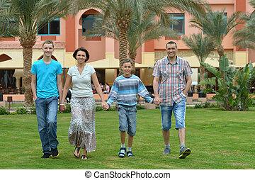 Family at tropical resort.