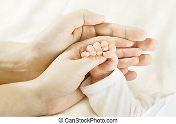 Family, babyand parents hands - Closeup of baby hand into...
