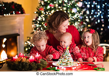 Family baking Christmas pastry - Happy family, young mother...
