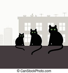 Family black cats sitting on the roof