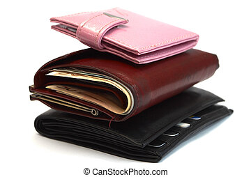 family budget concept. Three purses for mum, dad and child