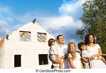 Family building a new house