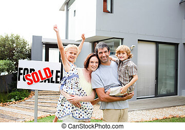 Family buying a house - Happy family buying a house