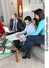 family buying a new house