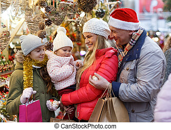Family buying Christmas decorations