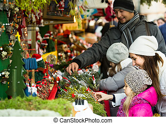 Family buying flower for Christmas - Parents with two little...