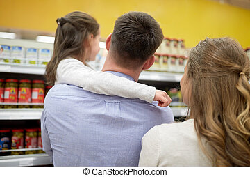 family buying food and shopping at grocery store - sale,...