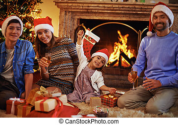Family by fireplace