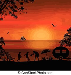 Family camping on beautiful campsite  on the beach at sunset