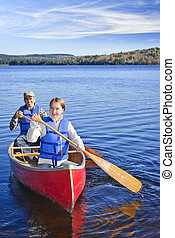 Family canoe trip - Father and daughter canoeing on Lake of...