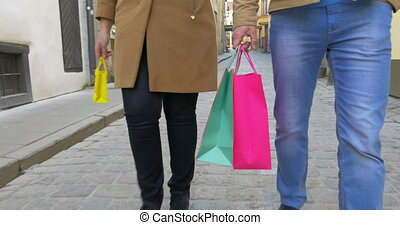 Family Carrying Shopping Bags