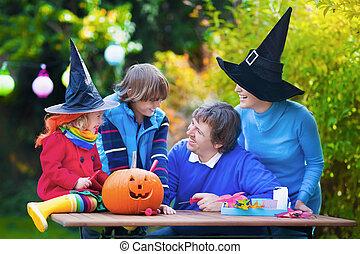 Family carving pumpkin at Halloween
