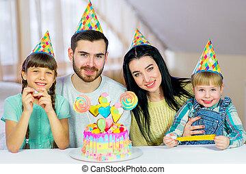 Family celebrates birthday with cake