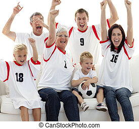 Family celebrating a goal at home