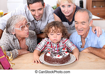 Family celebrating birthday boy