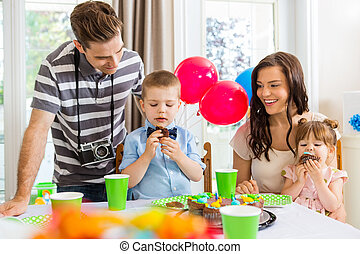Family Celebrating Birthday Party At Home