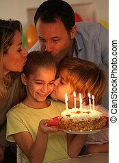 Family celebrating child's birthday