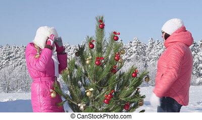 Family celebrating Christmas in snow
