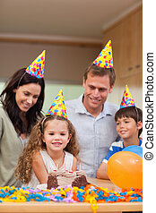 Family celebrating daughters birthday
