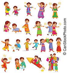Family celebrating Diwali - Family enjoying firecracker...